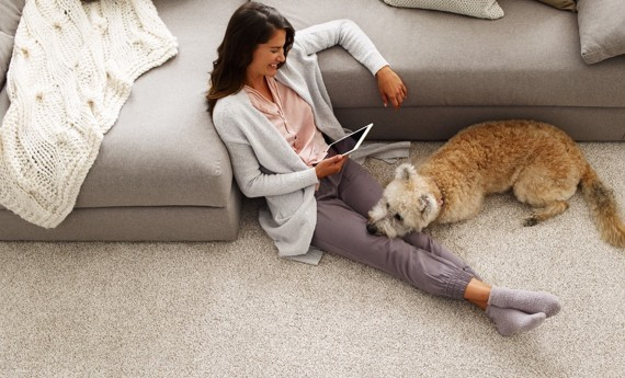 Lady on the carpet with her dog | baycountryfloors